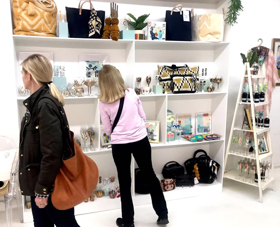 Shoppers enjoying one of the many downtown boutiques.